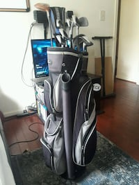 Old golf clubs and clean golf bag