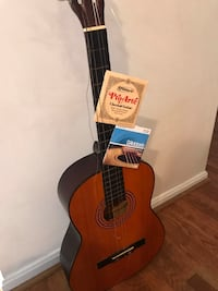 Acoustic guitar. With two sets of new strings   North Potomac, 20878