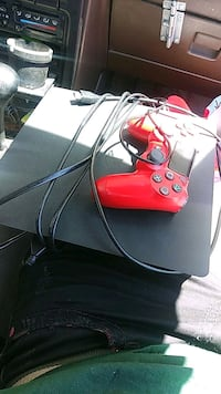 red and black Xbox One console with controller Fairfield