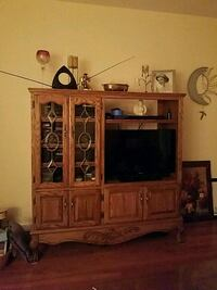 brown wooden TV hutch with flat screen television Queens, 11361