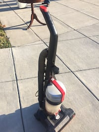 black and yellow upright vacuum cleaner