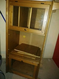 brown wooden framed glass cabinet New York, 10016