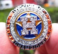 silver-colored and gold-colored diamond champion ring