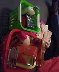 green and red plastic basket with toiletries Atlanta, 30354