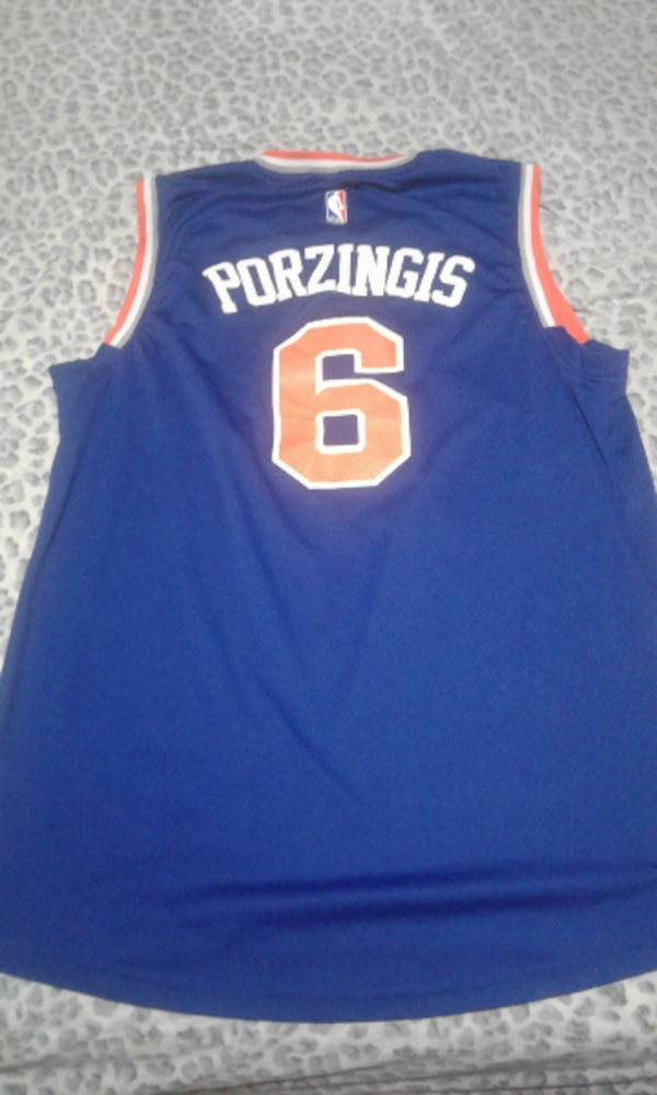 premium selection d64cf 9c0e0 blue, white, and orange Kristaps Porzingis of New York Knicks jersey shirt