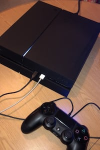 PlayStation 4 with control and wires first come first serve