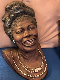 """Mahalia Jackson """" Cast bust """" with her most remembered features highlighted by the artist paint ."""