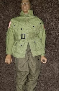 green button-up jacket plastic doll