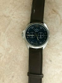 round silver chronograph watch with black leather strap 873 mi