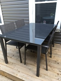 Glass topped aluminum patio dining set