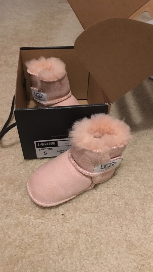 pair of toddler's size 8 pink UGG sheepskin boots with box