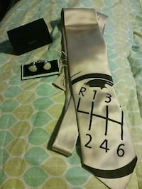 white and black neck ties with pair of white-and-silver cuff links Ruskin