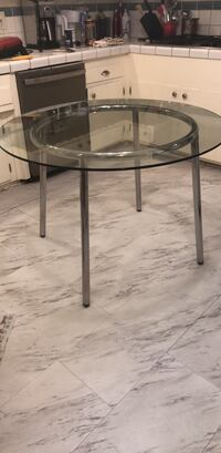 round glass top table with black metal base 2279 mi