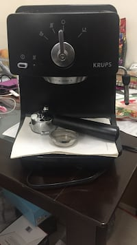 Black and gray Krups kitchen appliance