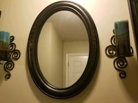 oval brown wooden framed mirror 68 km