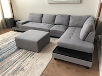 Grey sectional with attached side tables and ottoman Ottawa, K2V
