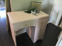 Sweet little pink desk/vanity. Cutest gold handles.Older but reloved