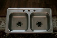 Stainless steel double sink with faucet holes Toronto, M2M 4B9