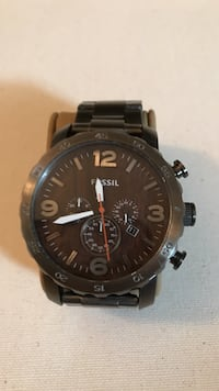 round black chronograph watch with black link bracelet