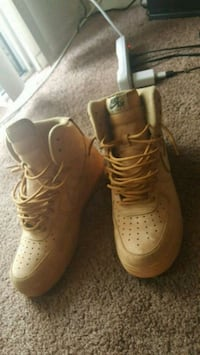 pair of wheat Nike Air Force 1 mid shoes