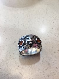 Silver gucci ring with gemstones and feline head