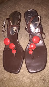 pair of brown leather sandals 72 km