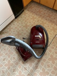 Red and black canister vacuum cleaner Saugus