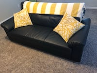 Black leather sofa with throw pillows Waxhaw, 28173