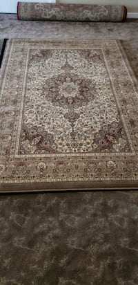 Main color is camel, 5'by8 new area rug