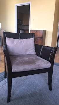 Brown wooden frame with light brown padded armchair Baltimore, 21202