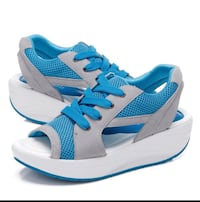 Pair of blue-and-white adidas sneakers North Vancouver, V7R 2L3