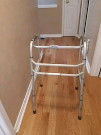 white and gray folding walker