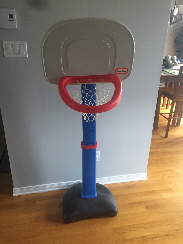 red, white, and black Little Tikes portable basketball hoop