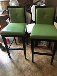 two green leather padded chairs Ontario