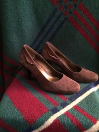 pair of brown suede cone-heeled shoes