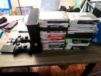 Xbox 360 console with game cases Bronx, 10457
