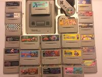 gray Nintendo Game Boy Advance with game cartridges Germantown, 20876