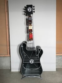Jack Daniels metal guitar display stand.