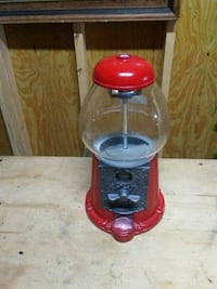 red and gray gumball dispenser 823 mi