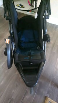 baby's black and blue jogging stroller Toronto, M2N 6H8