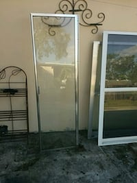 One  framed glass door Palmetto Bay