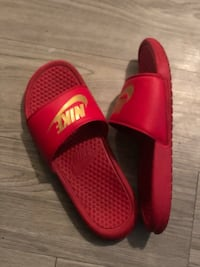pair of red-and-black Nike slide sandals Houston, 77069