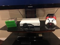 White xbox one s console. Comes with headset, 8 games, 1 original controller, 1 lava controller, controller charger that holds 2 controllers at a time. In very good condition Ajax, L1Z 0H5