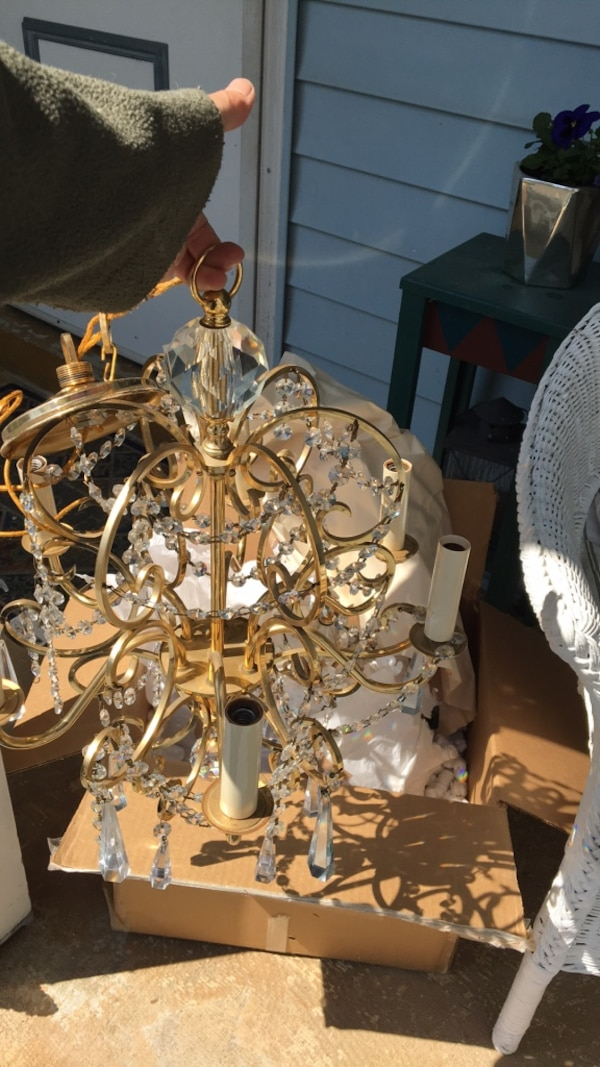 Two gold and crystal chandeliers