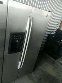 stainless steel side-by-side refrigerator with dis