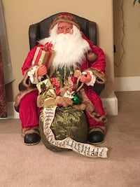 """29"""" tall and 19"""" wide. This Santa is seated in a leather chair with a list of children's names and a bag of gifts. Excellent condition. Just a little dust from storage. Antioch, 94509"""