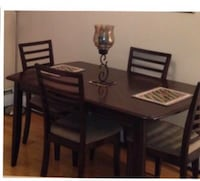 Table and cushioned  fabric/wood chairs