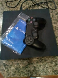 black Sony PS4 console with controller Puyallup, 98373