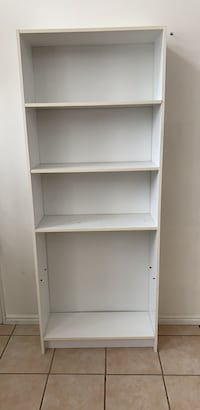 "white shelf 27 "" long by 69"" tall by10 "" deep  missing one shelf"
