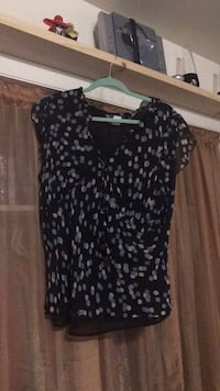 Black and with light blue and beige polka dot V neck shirt Alexandria, 22304